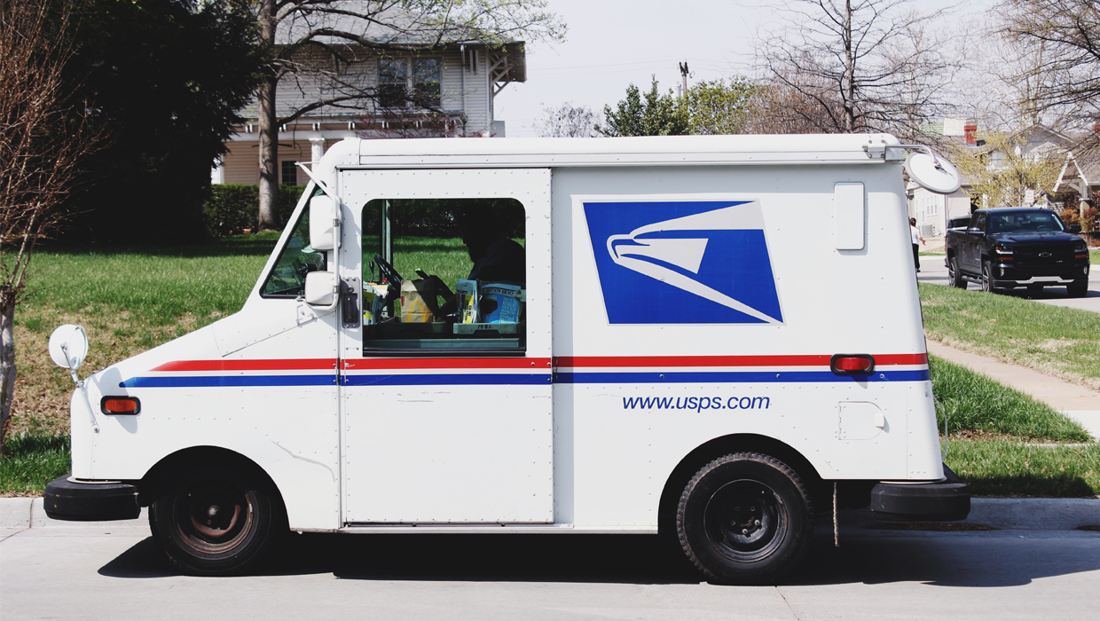 USPS Mail Delivery Truck - Photo by Pope Moysuh on Unsplash