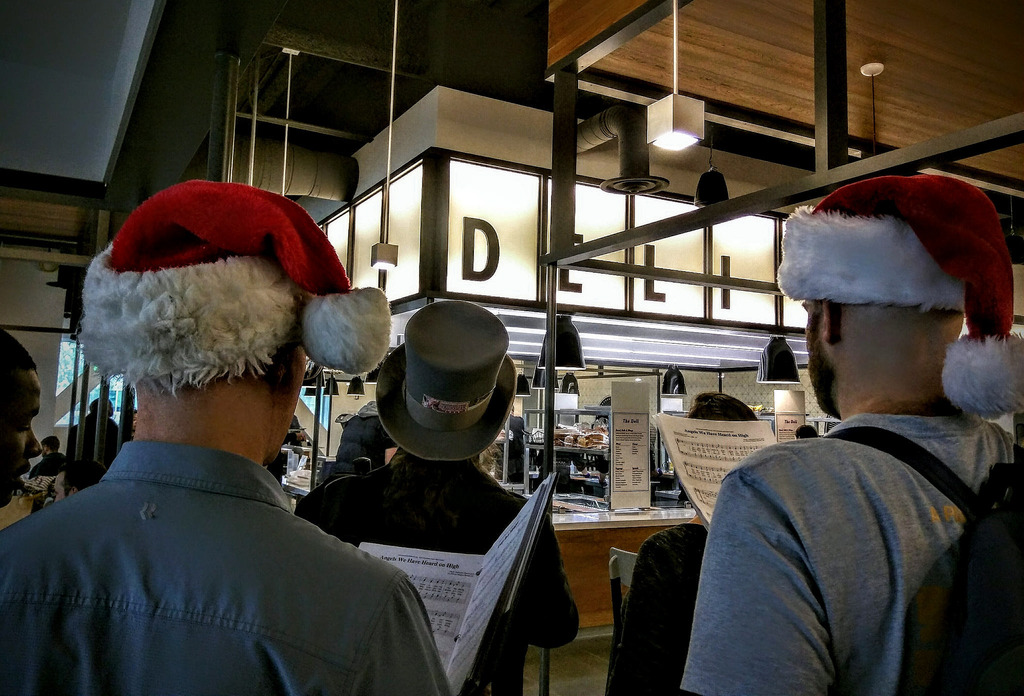 Carolers at deli