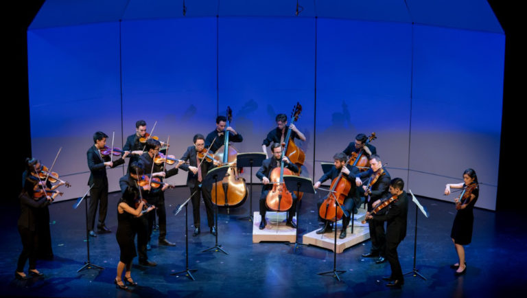 Kinetic ensemble string players performing